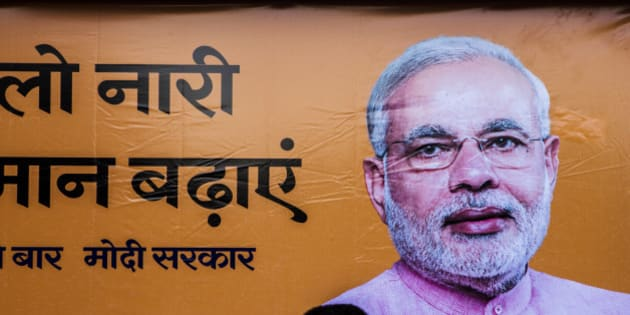 A pedestrian walks past a billboard for the Bharatiya Janta Party (BJP) picturing its prime ministerial candidate Narenda Modi as the third phase of voting for national elections commences in New Delhi, India, on Thursday, April 10, 2014. About 13 million voters spread across seven constituencies in Delhi will elect representatives along with voters in parts of Uttar Pradesh, Haryana, Maharashtra, Orissa and Kerala. Ninety-two seats will be decided today, although results from all 543 constituencies will be announced together on May 16. Photographer: Prashanth Vishwanathan/Bloomberg via Getty Images