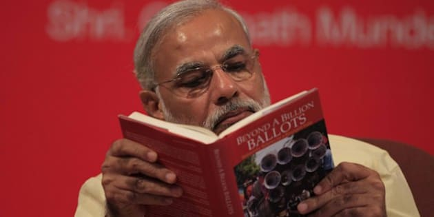 MUMBAI, INDIA - JUNE 27: Gujarat Chief Minister Narendra Modi reading the book Beyond A Billion Ballots by Vinay Sahasrabuddhe  at its launch at Bombay Stock on June 27, 2013 in Mumbai, India. It was his first visit to the city after he was made the head of BJP's Lok Sabha campaign committee over a fortnight ago. (Photo by Vijaynanand Gupta/Hindustan Times via Getty Images)