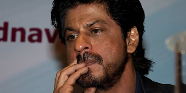 Indian Bollywood actor Shah Rukh Khan poses during the launch of the book Movers and Makers in Mumbai late April 27, 2016.   / AFP / STR        (Photo credit should read STR/AFP/Getty Images)