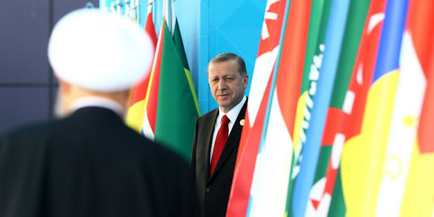 ISTANBUL, April 14, 2016 :   Turkish President Recep Tayyip Erdogan, right, attends the welcoming ceremony of the 13th Organization of Islamic Cooperation Summit in Istanbul, Turkey, on April 14, 2016. Turkey are hosting the two-day 13th OIC Summit on April 14-15. (Xinhua/Anadolu Agency via Getty Images)