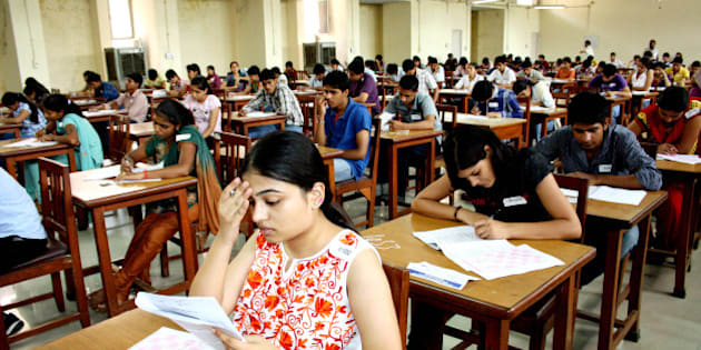 ROHTAK, INDIA - JULY 1: Post-graduation institute of medical science conducted the entrance exams for MBBS courses in PGI campus on July 1, 2012 in Rohtak, India. Students while taking exams at a exam centre. (Photo by Manoj Dhaka / Hindustan Times via Getty Images)