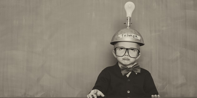 This young boy just can't think of the next big idea. Gridlock.