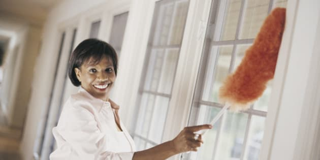 Woman Dusting Windows of Domestic Interior