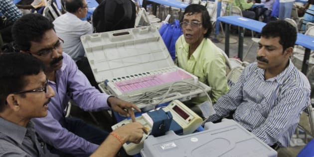 Indian polling officials check voting machines prior to leaving for their respective polling booths ahead of fifth phase of the West Bengal state Assembly elections in Kolkata, India, Friday, April 29, 2016. Fifth phase election will be held on April 30. (AP Photo/ Bikas Das)