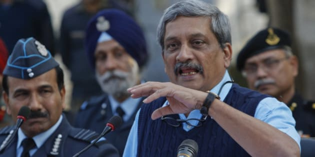 Indian Defense Minister Manohar Parrikar addresses the media at the Indian air force base in Pathankot, India, Tuesday, Jan.5, 2016. Indian forces have killed the last of the six militants who attacked the air force base near the Pakistan border over the weekend, the defense minister said Tuesday, though soldiers were still searching the base as a precaution. (AP Photo/Channi Anand)