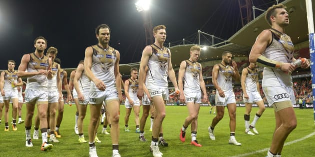 SYDNEY, AUSTRALIA - APRIL 30: Hawthorn Hawks show their dejection as they leave the field during the round six AFL match between the Greater Western Sydney Giants and the Hawthorn Hawks at Spotless Stadium on April 30, 2016 in Sydney, Australia.  (Photo by Brett Hemmings/AFL Media/Getty Images)