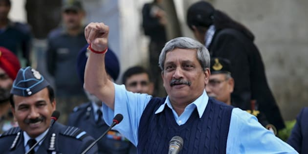 India's Defence Minister Manohar Parrikar gestures during a news conference as India's Air Chief Marshal Arup Raha (L) watches at the Indian Air Force (IAF) base at Pathankot in Punjab, India, January 5, 2016. Six militants who attacked an Indian air base have been confirmed killed, Parrikar said on Tuesday, adding that a four-day-old operation to secure the compound was still under way. REUTERS/Mukesh Gupta