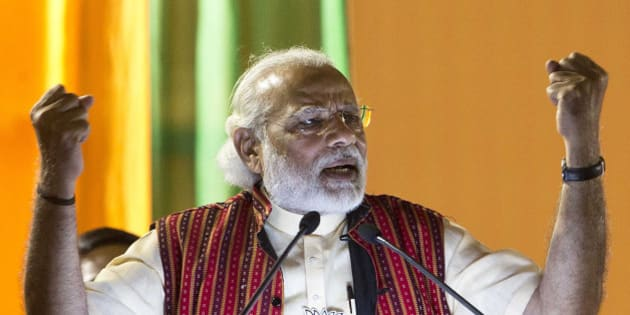 Indian Prime Minister Narendra Modi gestures as he delivers a speech at an election rally in Gauhati, India, Friday, April 8, 2016. Modi is on a campaigning tour of the north-eastern Indian state for the second and final phase of State Assembly elections. (AP Photo/ Anupam Nath)