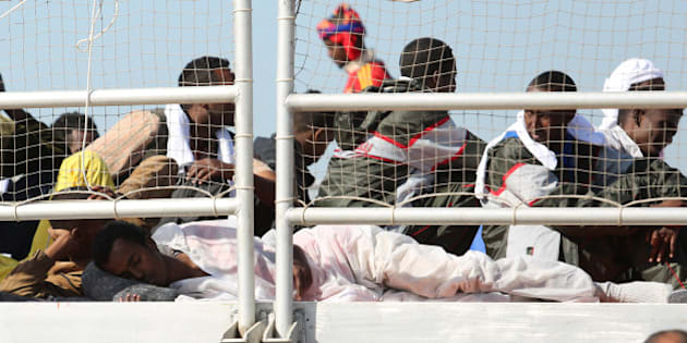 Migrants wait to disembark from the Migrant Offshore Aid Station vessel ' Phoenix ' in the harbor of Augusta, Sicily, Southern Italy, Saturday, May 9, 2015. European Union plans to introduce a quota system obliging countries to share the burden of settling refugees unraveled Friday as member nations began rejecting the scheme. (AP Photo/Francesco Malavolta)