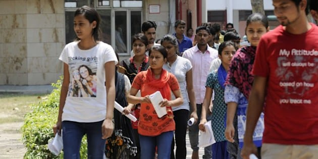NOIDA, INDIA - MAY 1: Medical aspirants coming out of the examination hall after appearing the All India Pre-Medical/Pre-Dental Entrance Test (AIPMT), on May 1, 2016 in Noida, India. The All Indian Pre-Medical Test (AIPMT) 2016, being treated as the first phase of the National Eligibility Entrance Test (NEET), was held on Sunday. The competitive examination held for entrance to MBBS and BDS courses across the country was held amidst tight security this year. Students had a proper dress code to adhere to as they were not allowed to enter the examination hall in shoes or carry any kind of stationary with them. Mobile phones were also not allowed. (Photo by Sunil Ghosh/Hindustan Times via Getty Images)