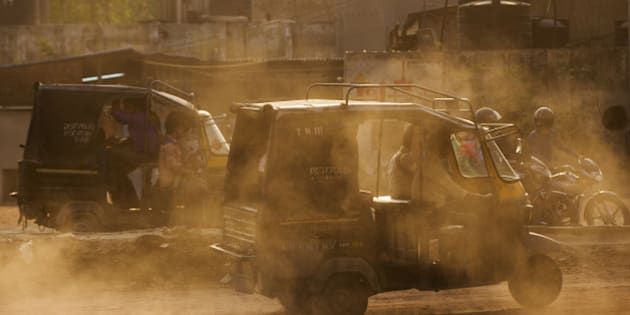 Auto-rickshaws kick up dust as they travel near the Delhi city boundary in Faridabad, Haryana, India, on Friday, April 8, 2106. The odd-even car rationing plan is scheduled to return on April 15 as Delhi Supreme Court is also set to hold a hearing regarding the large vehicle diesel ban. Both measures are aimed at curbing emissions in the world's most polluted city, according to a 2014 World Health Organization database. Photographer: Prashanth Vishwanathan/Bloomberg via Getty Images