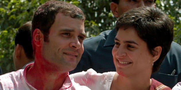 Rahul Gandhi (L) and his sister Priyanka Gandhi celebrate in the northern Indian city of Rae Bareli May 11, 2006. Rahul and Priyanka are children of Sonia Gandhi, the head of India's ruling Congress party. Indian communist parties took early leads on Thursday as votes were counted after polls for five state assemblies, the biggest electoral test of the ruling congress party since it came to power two years ago.  REUTERS/Pawan Kumar