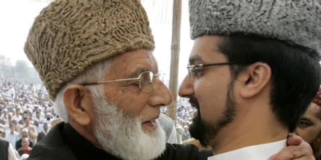 Mirwaiz Umar Farooq, (R) Chairman of Kashmir's moderate faction of All Parties Hurriyat (Freedom) Conference (APHC), and Syed Ali Shah Geelani Chairman of the hardliner faction of APHC hug on the occasion of Eid al-Fitr in Srinagar October 1, 2008. Thousands of Kashmiri Muslims attend special prayers in Eidgah during Eid-al-Fitr, which is celebrated at the end of the fasting month of Ramadan, the holiest month in the Islamic calendar. REUTERS/Danish Ismail (INDIAN-ADMINISTERED KASHMIR)
