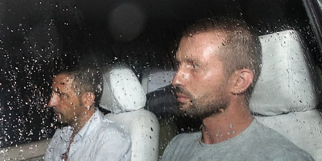 The two Italian marines accused of murdering two Indian fishermen leave after being released following a preliminary hearing on June 1, 2012 in a case that has caused a diplomatic row.  Massimiliano Latorre and Salvatore Girone, who shot dead the fishermen off India's southwestern coast on February 15, appeared in the lower court in Kollam in the southern state of Kerala. The two marines deny murder, saying they mistook the fishermen for pirates. The court fixed June 18 for the next hearing and directed the state government to provide a list of interpreters 'for the benefit of the accused', the semi-official Press Trust of India news agency reported.      AFP PHOTO        (Photo credit should read -/AFP/GettyImages)
