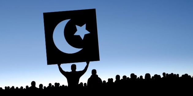 arab spring protestors in silhouette with crescent moon and star sign, panoramic frame (XXXL)