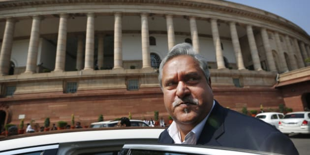 Indian business tycoon and owner of Kingfisher Airlines Vijay Mallya gets into his car outside Parliament in New Delhi, India, Wednesday, Feb. 27, 2013. According to local reports the Indian government has cancelled International flying rights and domestic slots of Kingfisher airlines. (AP Photo/Saurabh Das)