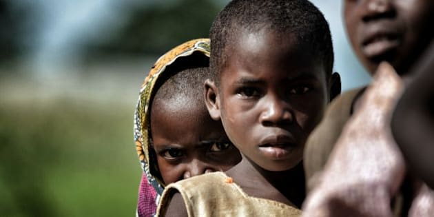 Children are pictured in the outskirts of Lilongwe on March 11, 2016. / AFP / ARIS MESSINIS / RESTRICTED TO EDITORIAL USE        (Photo credit should read ARIS MESSINIS/AFP/Getty Images)