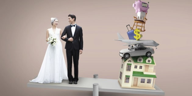 a couple getting married next to a pile of items