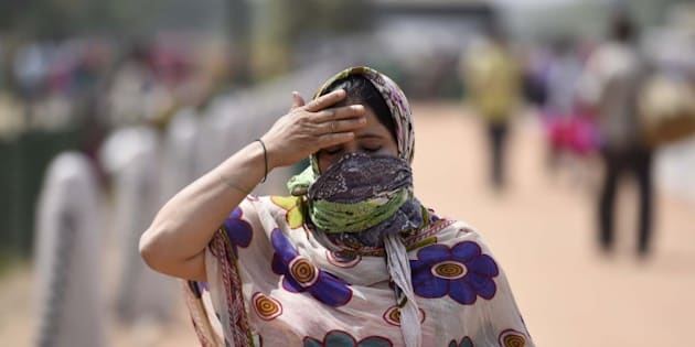 NEW DELHI, INDIA - APRIL 2: People cover themselves to protect against the hot summer day, as the heat wave conditions prevailed in Northern India with the maximum temperature settling at 38.9 degrees Celsius, five notches above the normal, on April 02, 2016 in New Delhi, India. The minimum temperature yesterday was recorded at 21.6 degrees Celsius while the maximum had settled at 37.3 degrees Celsius. (Photo by Sonu Mehta/Hindustan Times via Getty Images)