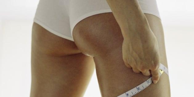 Woman measuring thigh