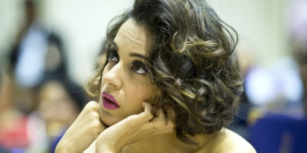 Indian actress Kangana Ranaut listens to a speaker before receiving her national award for best actress from Indian President Pranab Mukherjee in New Delhi, India, Tuesday, May 3, 2016. Ranaut won the award for her performance in Tanu Weds Manu Returns. (AP Photo/Saurabh Das)