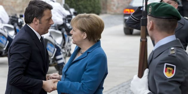 HANOVER, GERMANY - APRIL 25: German Chancellor Angela Merkel (R-2) welcomes Italian Prime Minister Matteo Renzi (L) before their meeting at Schloss Herrenhausen palace in Hanover, Germany on April 25, 2016. (Photo by Mehmet Kaman/Anadolu Agency/Getty Images)