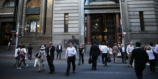 SYDNEY, AUSTRALIA - MAY 05:  Pedestrians walk towards Martin Place in the central business district on May 5, 2015 in Sydney, Australia. Forecasters are predicting the Reserve Bank of Australia will cut interest rates for the second time this year in its upcoming May meeting. The cuts would come amidst fear of stoking the rising prices of housing in Australia.  (Photo by Mark Metcalfe/Getty Images)