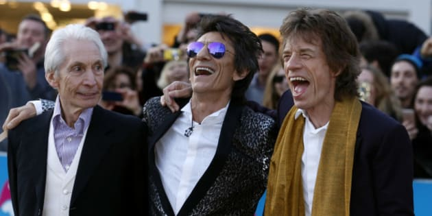 "Members of the Rolling Stones (L-R) Charlie Watts, Ronnie Wood and Mick Jagger laugh as they arrive for the ""Exhibitionism"" opening night gala at the Saatchi Gallery in London, Britain April 4, 2016. REUTERS/Luke MacGregor"