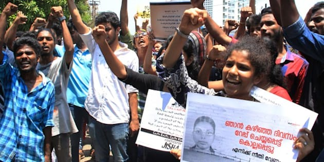 Indian protestors shout slogans during a demonstration against the rape and murder of a woman in Kochi on May 3, 2016.  Indian police detained three people May 3 over the brutal rape and murder of a young student in the southern state of Kerala, in a case echoing the 2012 gang-rape of a Delhi woman that sparked mass protests. Police said the attack on the 30-year-old law student from the lowest Dalit caste was so vicious she was found lying dead in a pool of blood, her intestines hanging out. Her mother discovered her body at the family home in the southern state of Kerala.  / AFP / STR        (Photo credit should read STR/AFP/Getty Images)