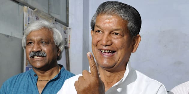 DEHRADUN, INDIA - MAY 7: Uttrakhand Chief Minister Harish Rawat showing ink stained finger after casting his vote at polling centre during 8th phase of Lok Sabha election on May 7, 2014 in Dehradun, India. 1,737 candidates are contesting on 64 seats in seven states in eighth phase of Lok Sabha election. (Photo by Rishi Ballabh/Hindustan Times via Getty Images)