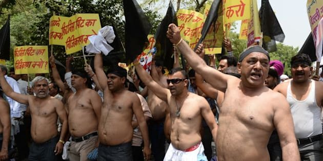 Indian taxi drivers and owners shout slogans against Delhi's Chief Minister Arvind Kejriwal during a protest in New Delhi on May 4, 2016, against the banning of diesel cabs on the roads in the Indian capital. 