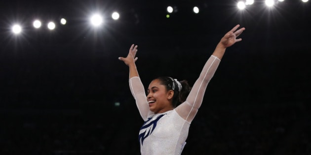 India's Dipa Karmakar reacts after a successful vault during the women's gymnastics vault apparatus final at the 2014 Commonwealth Games in Glasgow, Scotland, July 31, 2014. REUTERS/Phil Noble (BRITAIN - Tags: SPORT GYMNASTICS)
