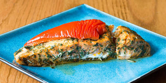TORONTO, ONTARIO, CANADA - 2016/04/22: Canadian cuisine: salmon stuffed with cheese, marinated with herbs and garnished with red pepper. (Photo by Roberto Machado Noa/LightRocket via Getty Images)