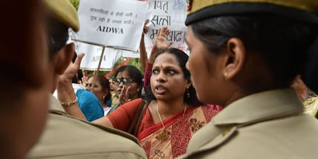 Indian activists shout slogans as they are confronted by police officials during a protest outside Kerala House in New Delhi on May 4, 2016, following the rape of a student in the southern Indian state of Kerala.  Indian police detained three people May 3, over the brutal rape and murder of a young student in the southern state of Kerala, in a case echoing the 2012 gang-rape of a Delhi woman that sparked mass protests. Police said the attack on the 30-year-old law student from the lowest Dalit caste was so vicious she was found lying dead in a pool of blood, her intestines hanging out. Her mother discovered her body at the family home in the southern state of Kerala. / AFP / SAJJAD HUSSAIN        (Photo credit should read SAJJAD HUSSAIN/AFP/Getty Images)