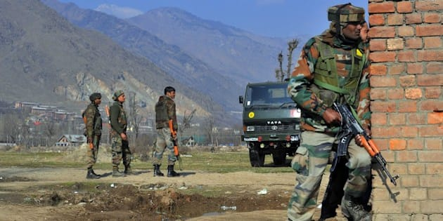PULWAMA, INDIA - 2016/02/21: Indian army soldiers stand alert near the encounter site  in Pampore. Six persons were killed including three CRPF soldiers, two Indian army captains and a civilian when suspected militants attacked a military convoy on Srinagar National high way near Pampore. the militants then took refuge in a nearby government building Where a gun battle between government forces and militants is underway, police said. (Photo by Faisal Khan/Pacific Press/LightRocket via Getty Images)
