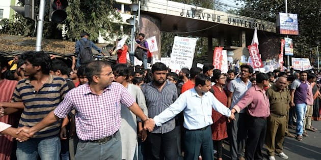 KOLKATA, INDIA - FEBRUARY 18: Professors and students of Jadavpur University during a protest against Jawaharlal Nehru University issue, demanding strict action against the traitors who raised anti-national slogans in the JNU, on February 18, 2016 in Kolkata, India. JNU has been on the boil over the arrest of its student's Union President Kanhaiya Kumar on sedition charges after some students organised a meet to mark the anniversaries of executions of Parliament attack convict Afzal Guru. Delhi's Patiala House Court on Wednesday sent JNU student union leader Kanhaiya Kumar to judicial custody till March 2. (Photo by Subhendu Ghosh/Hindustan Times via Getty Images)