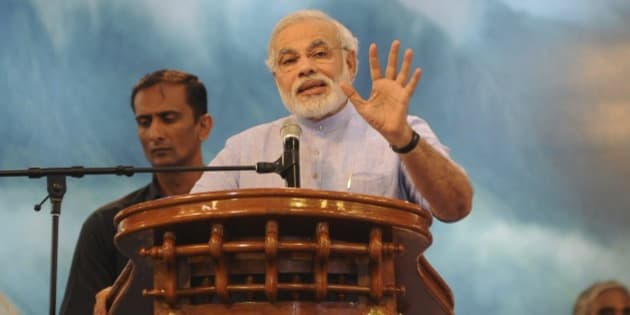 """Gujarat Chief Minister Narendra Modi, speaks during the 60th birthday celebrations of Indian spiritual leader Mata Amritanandamayi, at Vallikavu, near Kollam, Kerala state, India, Thursday, Sept. 26, 2013. Known among her followers as """"Amma,"""" which means """"mother"""" in several Indian languages, Amritanandamayi has devotees in India and the rest of the world where she is more known as the Hugging Saint. India's opposition Bharatiya Janata party (BJP) had earlier named Modi as its candidate for prime minister in national elections next year.(AP Photo)"""