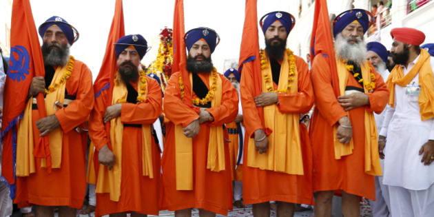 Sikh devotees participate in the Baisakhi festival at Panja Sahib shrine in Hassan Abdel April 13, 2015. Hundreds of Indian Sikh pilgrims arrived into Pakistan to celebrate the Baisakhi festival with Pakistani Sikhs at the shrines of Panja Sahib and Nankana Sahib, the birth place of Sikh faith founder Guru Nanak Dev. REUTERS/Caren Firouz