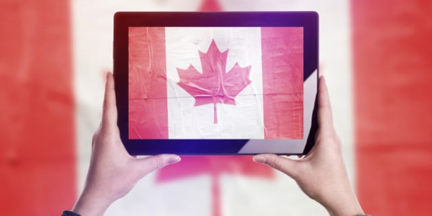 Person Taking Picture of Canada Flag with Digital Tablet Computer, Vintage Tone Retro Effect