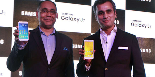 NEW DELHI, INDIA - JULY 16: Manu Sharma (L), Director, Mobile at Samsung India and Asim Warsi, Vice President of Marketing, IT and Mobile at Samsung India during the launch of the Samsung Galaxy J5 and Galaxy J7 on July 16, 2015 in New Delhi, India.  Samsung expanded its range of Galaxy smartphones by launching two new 4G phones J5 and J7 in India. Electronics giant has tied up with Flipkart to offer the phones exclusively on the online platform. Both the phones can be pre-booked between July 16 and July 22. (Photo by Sanjeev Verma/Hindustan Times via Getty Images)