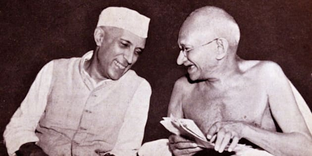 Pandit Jawaharlal Nehru, later Prime Minister of India, (left) with Mohandas Karamchand Gandhi (1869 – 1948), the preeminent leader of the Indian independence movement in British-ruled India. (Photo by: Universal History Archive/UIG via Getty Images)