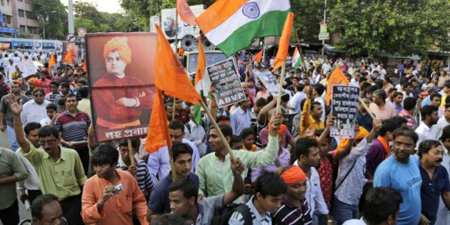 Supporters of Akhil Bharatiya Vidyarthi Parishad (ABVP), affiliated students' union of ruling Bharatiya Janata Party (BJP) walk in a protest rally near Jadavpur University in Kolkata, India, Monday, May 9, 2016.  (AP Photo/ Bikas Das)