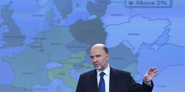 European Commissioner for Economic and Financial Affairs Pierre Moscovici presents the EU executive's spring economic forecasts during a news conference at the EU Commission headquarters in Brussels May 5, 2015. Euro zone economic growth will be stronger than previously expected this year thanks to cheaper oil, a weaker euro, stable global growth and supportive fiscal and monetary policies, the European Commission said on Tuesday. REUTERS/Yves Herman