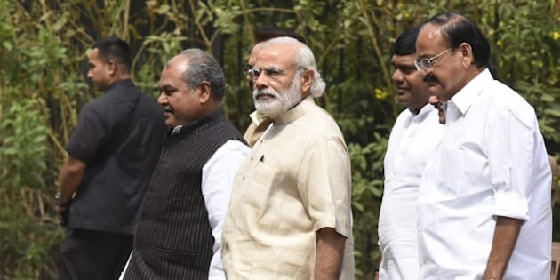 NEW DELHI, INDIA - MAY 3: Prime Minister Narendra Modi (C), Union Parliamentary Affairs Minister M. Venkaiah Naidu (L), Union Minister of Mines, Steel, Labour and Employment Narendra Singh Tomar (R) leave after attending the BJP Parliamentary Board Meeting at Parliament Library on May 3, 2016 in New Delhi, India. With the BJP mounting an offensive against Congress vice-president on the AgustaWestland VVIP chopper bribery case, Rahul Gandhi on Wednesday said he is happy to be targeted. (Photo by Sonu Mehta/Hindustan Times via Getty Images)