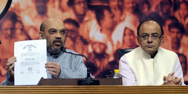 NEW DELHI, INDIA MAY 09: Finance Minister Arun Jaitley and BJP President Amit Shah during a press conference to show the degrees of Prime Minister Narendra Modi at BJP headquarters in New Delhi.(Photo by Pankaj Nangia/India Today Group/Getty Images)