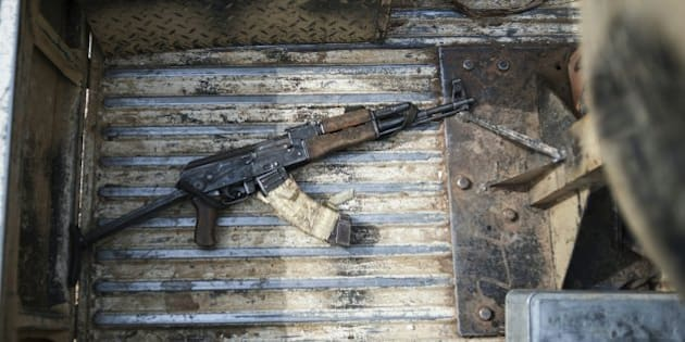 An AK47 machine gun in the back of a military vehicle in Mbalala, Borno State northeast Nigeria on March 25, 2016.   On April 14, 2014, Boko Haram militants kidnapped 276 schoolgirls from their dormitories at the Government Girls Secondary School Chibok, drawing global attention to the Islamist insurgency in northeast Nigeria. / AFP / STEFAN HEUNIS        (Photo credit should read STEFAN HEUNIS/AFP/Getty Images)