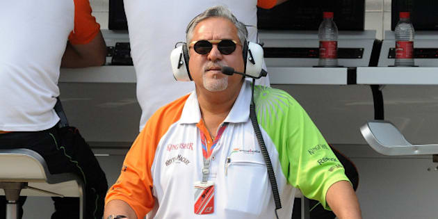 Force India-Mercedes Team Principal Vijay Mallya watches the big screen during the first practice session of Formula One's Indian Grand Prix at the Buddh International circuit in Greater Noida on October 28, 2011. India will host its first Formula One Grand Prix on October 30. AFP PHOTO/ Prakash SINGH (Photo credit should read PRAKASH SINGH/AFP/Getty Images)