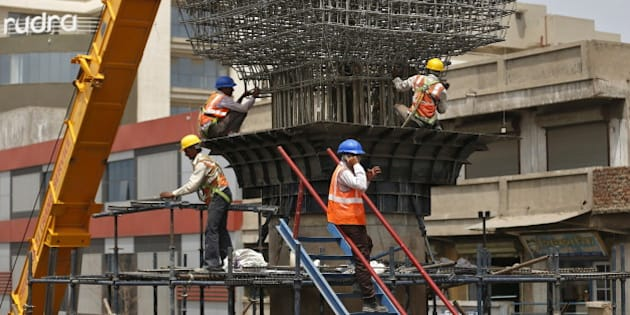 Labourers work at the site of metro railway flyover under construction in Ahmedabad, India, March 31, 2016. India's infrastructure output grew an annual 5.7 percent in February, its fastest pace in at least 13 months, mainly driven by a surge in production of cement and fertilizers, government data showed on Thursday. REUTERS/Amit Dave
