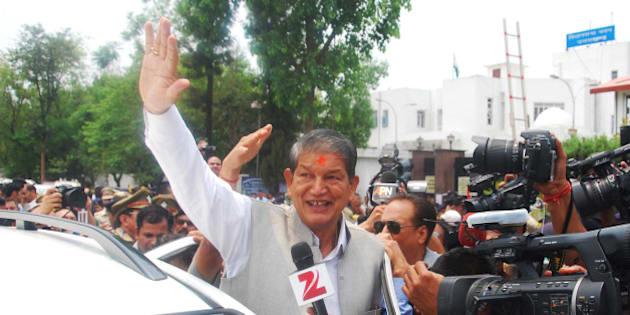 DEHRADUN, INDIA - MAY 10: Uttarakhand former Chief Minister Harish Rawat interacting with media after the floor test outside the assembly, on May 10, 2016 in Dehradun, India. Rawat has claimed victory in the trust vote held today in the Uttarakhand Assembly. The results will be handed over to the Supreme Court in a sealed cover, and the court will declare the results at 10:30 am on Wednesday. (Photo by Vinay Santosh Kumar/Hindustan Times via Getty Images)
