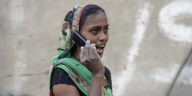 An Indian woman speaks on a mobile phone in Suraj village in Mehsana district, some 100 km from Ahmedabad, on February 20, 2016.  A village in Indian Prime Minister Narendra Modi's home state of Gujarat has banned single women from using mobile phones, with elders deeming the technology a 'nuisance to society'.  AFP PHOTO / Sam PANTHAKY / AFP / SAM PANTHAKY        (Photo credit should read SAM PANTHAKY/AFP/Getty Images)